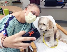 Woody dog visiting a patient